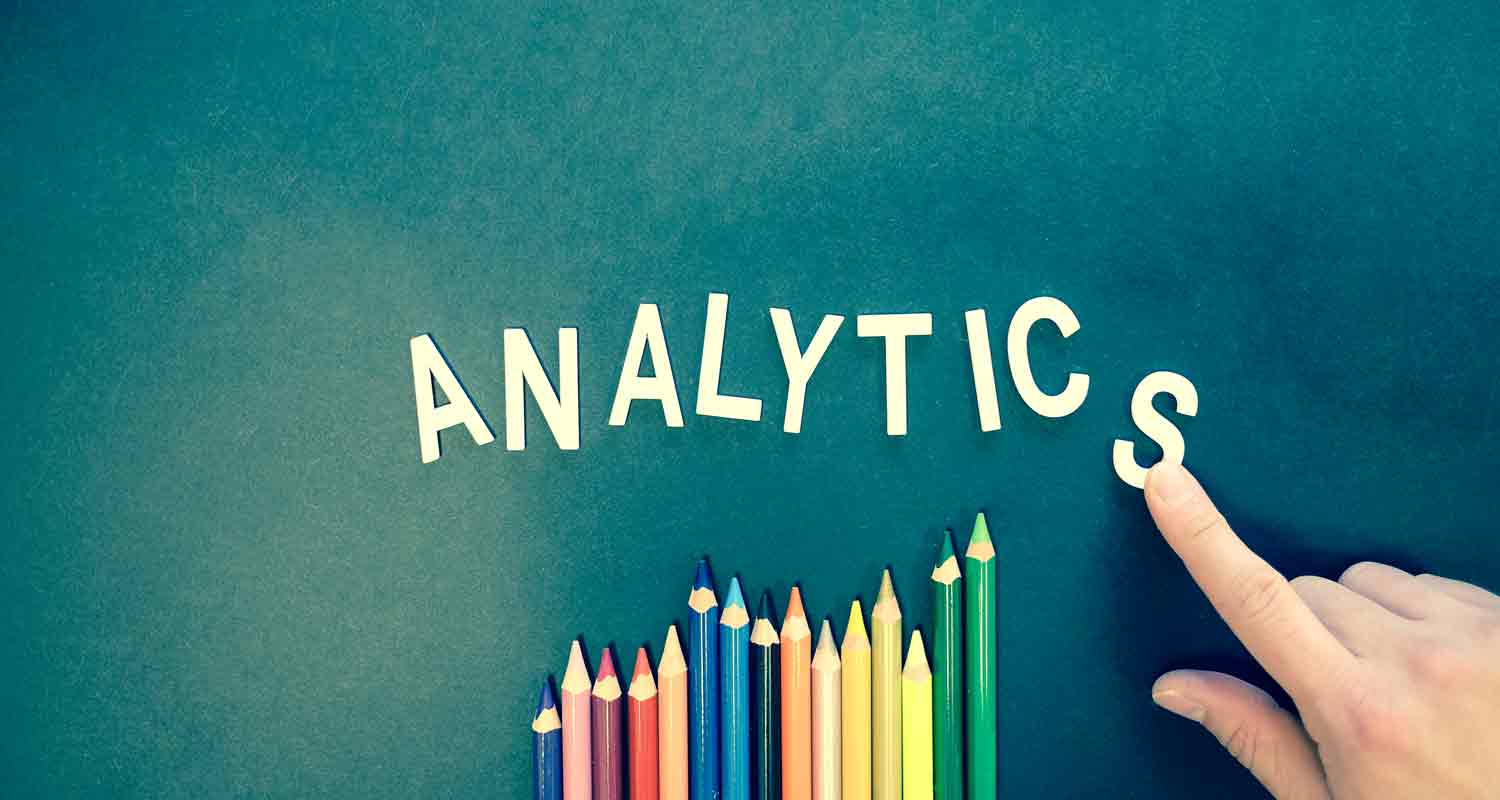 Analytics spelt out next to coloured pencils