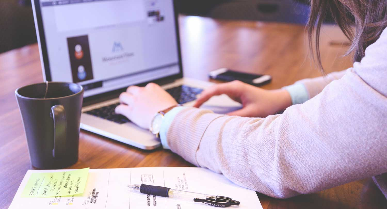 Marketer undertaking competitor analysis